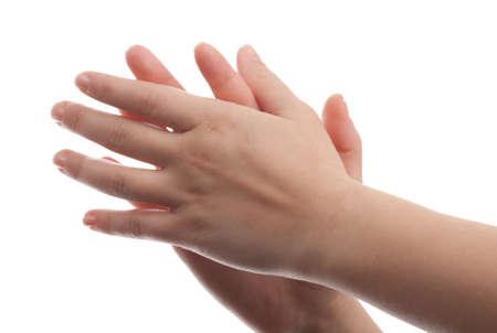 manos aplaudiendo: La mujer golpeó las manos aisladas en blanco Foto de archivo