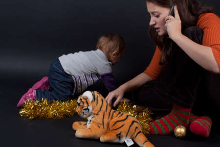 Mother and daughter playing at christmas. Studio shoot. Stock Photo - 16672608