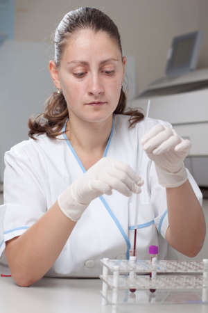 erythrocyte: Woman doctor doing erythrocyte sedimentation rate test in laboratory Stock Photo