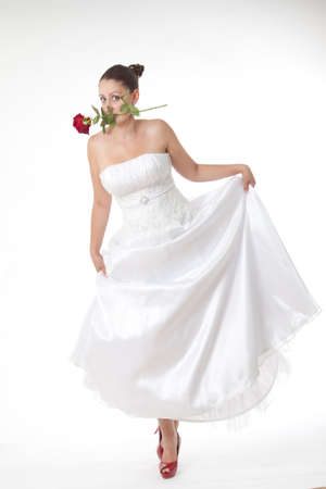Bride in white with high heel red shoes Stock Photo - 23780914