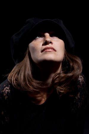 Woman portrait with black hat. Studio shot.