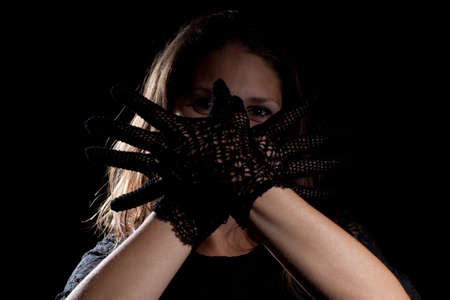 Woman with black gloves. Studio shot.