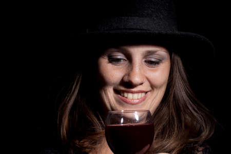 Woman with glass full of wine. Studio shot. Stock Photo