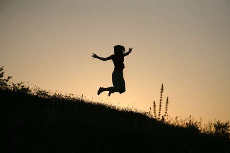 jumping happy young woman photo