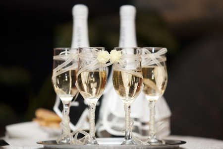lot of glasses with champagne during on the wedding party table  photo