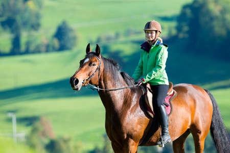 horse saddle: Woman riding a horse