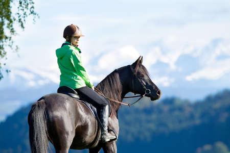 Woman riding horse photo
