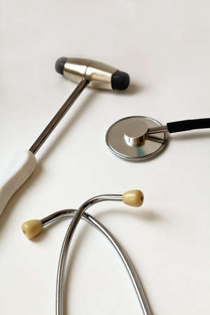 neurological: close-up view of stethoscope and neurological hammer