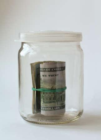 stash: bundle of american dollars in glass jar