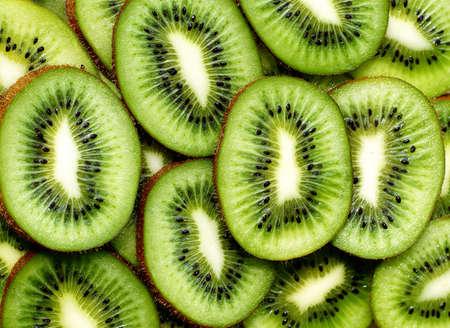 kiwi fruta: fondo kiwi fresco. rodajas de cerca