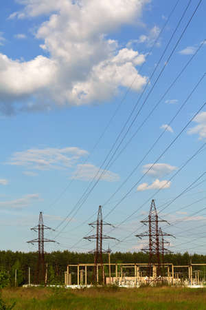 megawatts: power lines and wires. sunny day. vertical