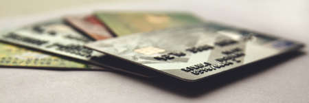stack of credit cards, close up view with selective focus. panorama.