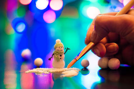New Year, design photo mysterious bright night snowman handmade copy space. Mockup for postcard. Hand Maid, miniature