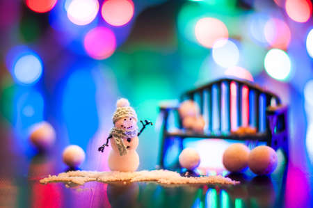 New Year, design photo mysterious bright night snowman bench copy space. Mockup for postcard. Hand Maid, miniature