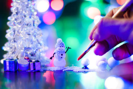 New Year, design photo mysterious bright night handmade snowman Christmas tree gifts copy space. Mockup for postcard. Hand Maid, miniature