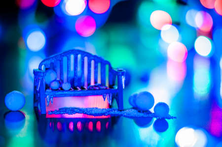 New Year, design photo mysterious bright night bench, snow, mittens copy space. Mockup for postcard. Hand Maid, miniature