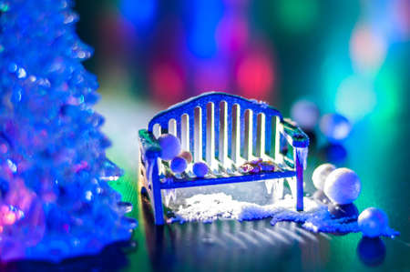 New year, design photo mysterious bright night bench, snow, mittens Christmas tree copy space. Mockup for postcard. Hand Maid, miniature