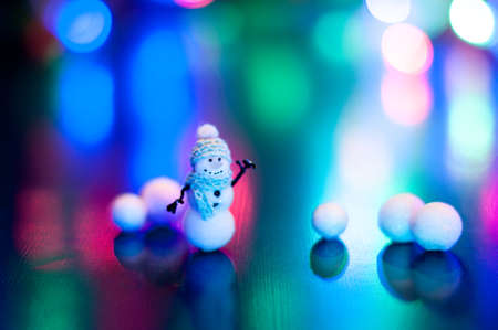 New Year, design photo mysterious bright night snowman snow copy space. Mockup for postcard. Hand Maid, miniature