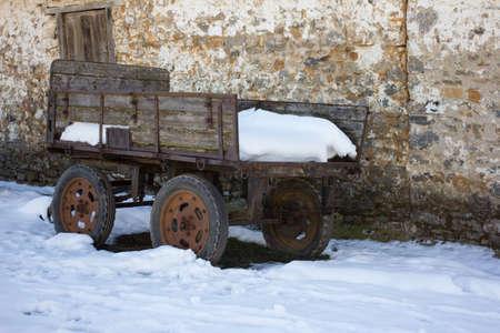 barns winter: Aged snow covered caravan Stock Photo