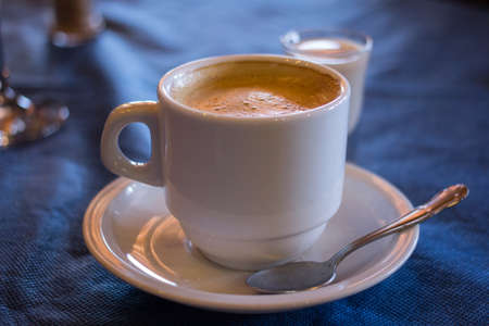 liqueurs: Cup of coffee and a shot of liqueur