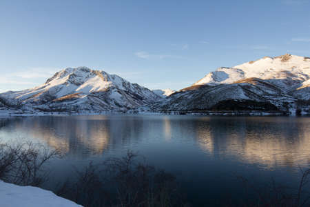 scenary: Snow covered mountain Reflected on a lake