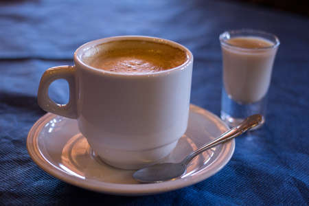 liqueur: Coffee and a shot of liqueur Stock Photo