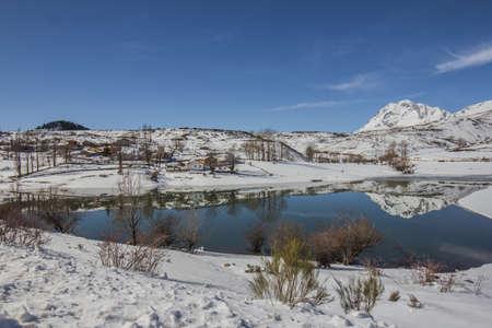 snow covered mountain: Snow covered mountain Reflected on a lake