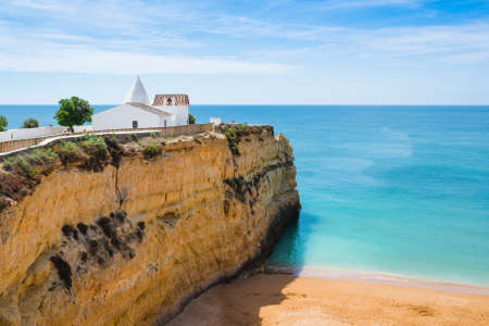 senhora: The Chapel of Nossa Senhora da Rocha on top of the spectacular cliffs on Nova Beach. Region Algarve. Portugal Stock Photo