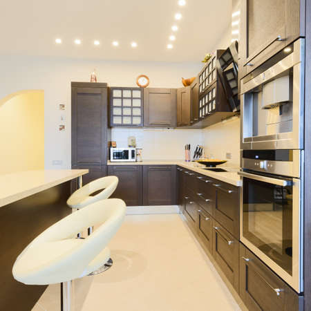 Elegant kitchen with dining area in a modern style