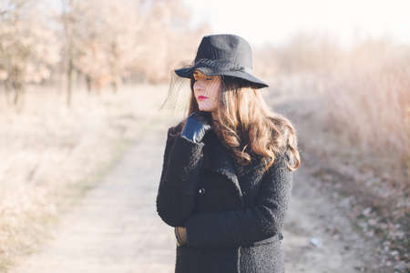 jewlery: Portrait of a young woman wearing a hat Stock Photo