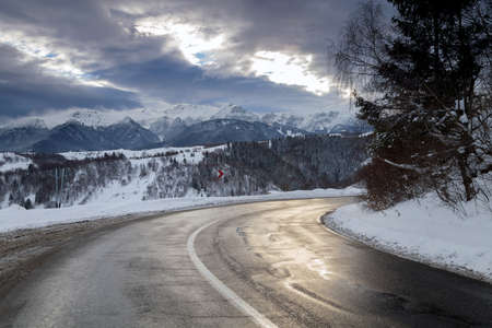highroad: Beautiful mountain road in winter Stock Photo
