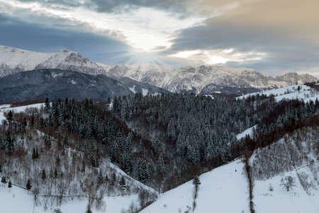 Beautiful winter sunset, in Bucegi mountains, Carpathians, Romaniaa Stock Photo