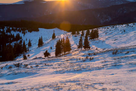 Winter sunset landscape in the Carpathian Mountains