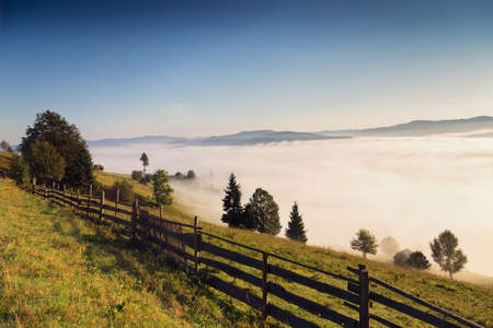 Beautiful foggy morning in the romanian village, in Bucovina