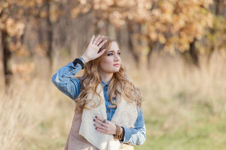 Autumn portrait of a beautiful young woman Stock Photo