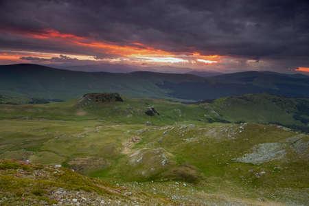 Summer sunrise landscape in the Carpathians Mountains, on Transalpina mountain road, Romania Zdjęcie Seryjne