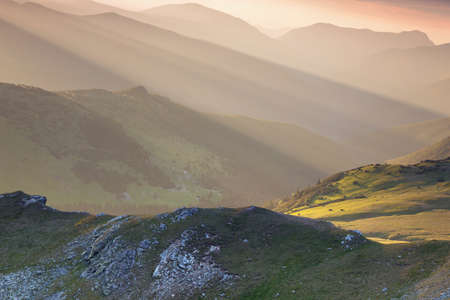 Summer sunrise landscape in the Carpathians Mountains, on Transalpina mountain road, Romania 版權商用圖片
