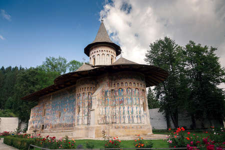 Voronet orthodox painted monastery, Bucovina, listed in UNESCOs list of World Heritage sites Stock Photo