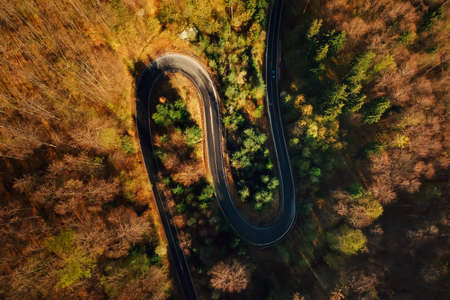 Autumn aerial view of mountain road at sunrise