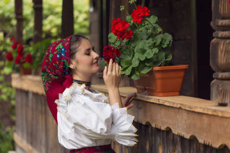 Portrait of a beautiful young woman wearing traditional Romanian clothes, in Maramures 스톡 콘텐츠 - 102253329