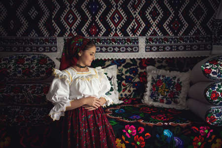 Portrait of a beautiful young woman wearing traditional Romanian clothes, in Maramures Zdjęcie Seryjne