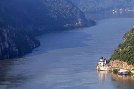 Summer landscape of Danube Gorge, at the border between Romania and Serbia. Mraconia orthodox monastery Reklamní fotografie