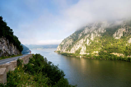 Summer landscape of Danube Gorge, at the border between Romania and Serbia. Mraconia orthodox monastery 스톡 콘텐츠
