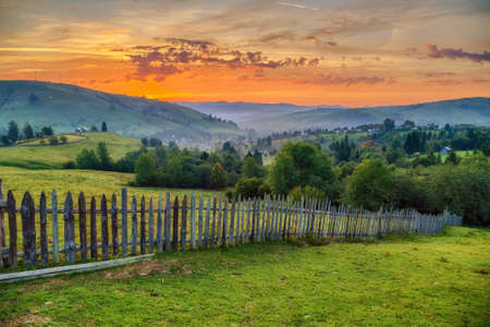 Summer landscape at sunrise, in Bucovina Imagens - 107258641