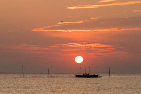 Fishermen at sunrise at the Black Sea 写真素材