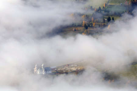 Foggy morning in Bucovina. Foggy landscape of a rural church in the romanian village Reklamní fotografie - 116782567