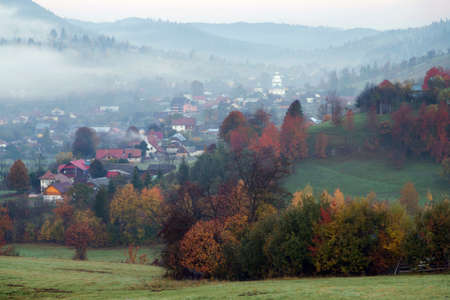 Foggy morning in Bucovina. Autumn colorful landscape in the romanian village 스톡 콘텐츠 - 116785871