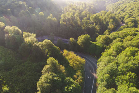 Aerial view of a beautiful mountain road, at sunrise Stockfoto