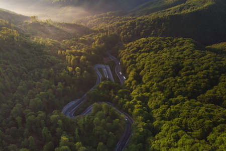 Aerial view of a beautiful mountain road, at sunrise Stock fotó