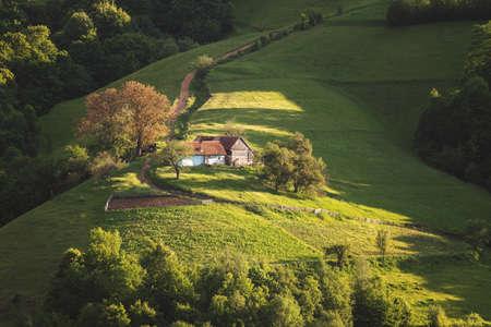 Beautiful summer green hills in Transylvania. Sunrise landscape in the Romanian mountain village